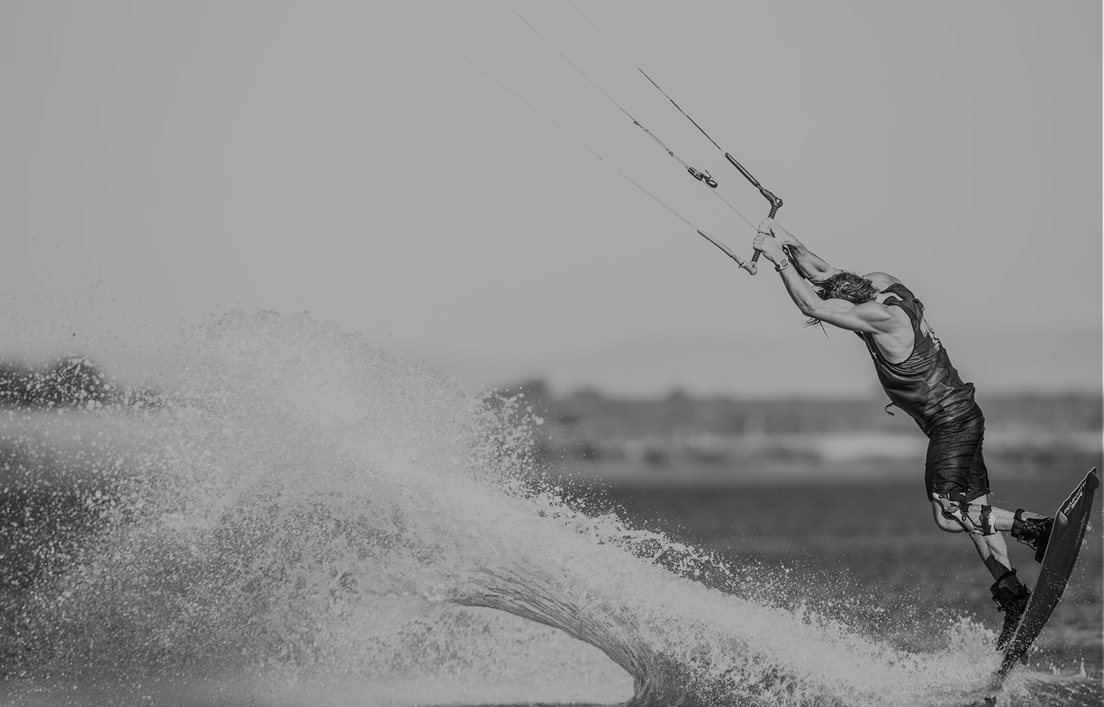 Banner image of a man kiteboarding